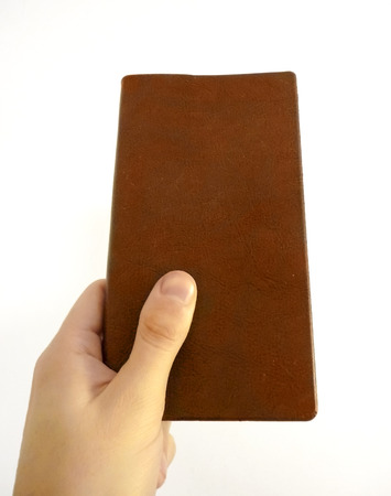 discipleship: Hand holding a book against a white background