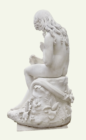 Classic style sculpture of a nude human figure with long wavy hair in a strange pose sitting on a ornate seat  against white background photo