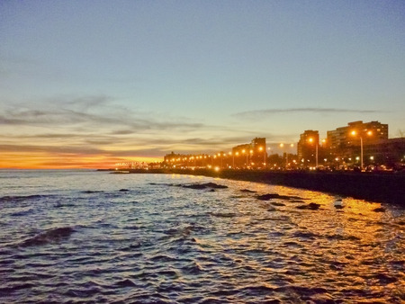 Night view scene of part of the boardwalk of Montevideo, the capital city of Uruguay in South America Imagens