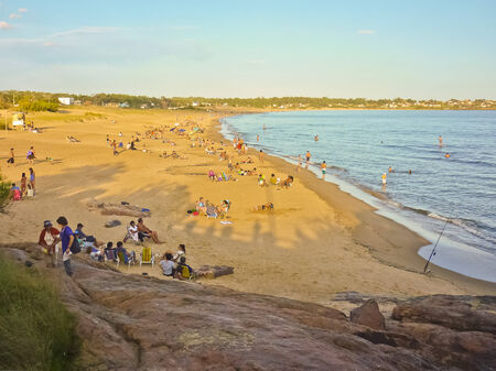 Crowded enjoying summer at the beach in an spa in south america, uruguay  photo