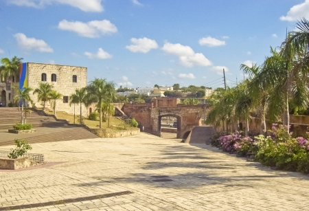 dominican republic: Santo Domingo square park outdoor view with an ancient building in the background in a sunny day