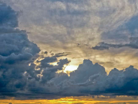 Big breathtaking clouds with the sun behind in a summer day in Uruguay. photo