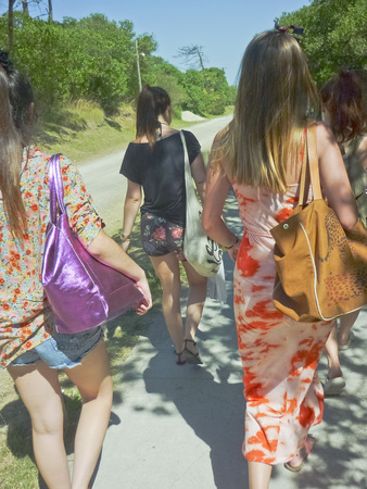 A group of beatiuful girls walking to the beach in the atlantic coast of Argentina, South America. photo