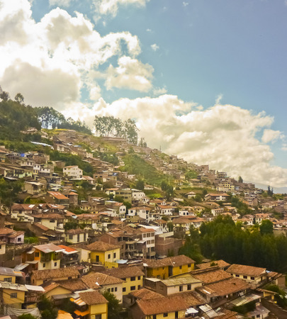 highs: Famous colonial historic cusco city houses in the highs of a mountain.
