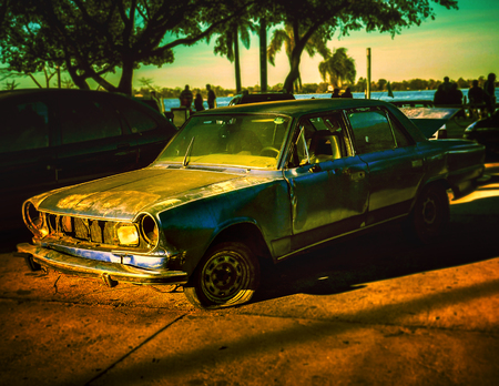 Digital edited and color manipulated photo of an abandoned car in the north coast of Rosario city in Argentina, South America photo