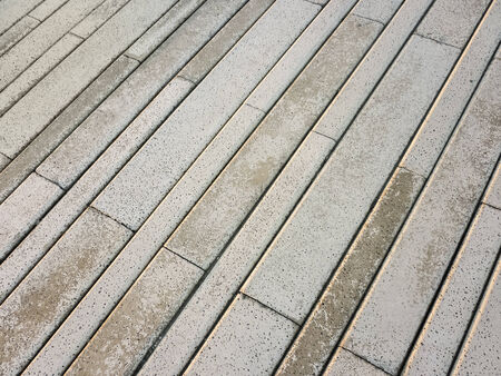 Exterior floor block texture in diagonal composition useful , material texture or pattern photo