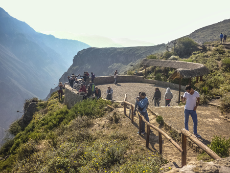 sighting: COLCA VALLEY AREQUIPA, PERU - APRIL 2014 - Group of people waiting for the appearance of condors in the place of sighting in the Colca Valley