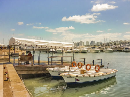 Punta del Este port view whit small old boats as the main subject and others boats and yatchts in the background