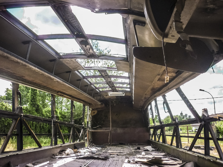 Inside abandoned burned bus in the field. photo