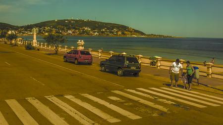 edited photo: PIRIAPOLIS, URUGUAY - APRIL 2013 - Retro style digital edited editorial photo of the boardwalk of Piriapolis, a beautiful seaside resort near Punta del Este in the coast of Uruguay.