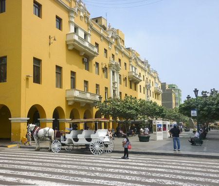municipal editorial: LIMA, PERU, APRIL 2014 - Plaza Mayor in the historic center of Lima city in Peru South America with a beautiful colonial style yellow buildings as the main subject