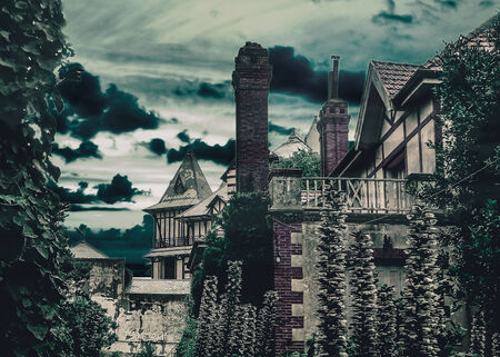 manipulated: Dark scene night village digital manipulated and color edited photograpy of medieval houses with plants and trees around and cloudy sky in background. Stock Photo
