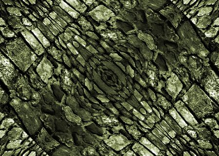 photo manipulation: Digital photo manipulation technique rocks pattern texture in dark green tones also useful as background or material. Stock Photo