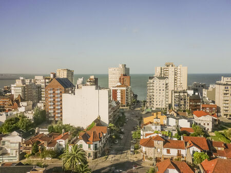 Aerial view of buildings and ocean in the city of Mar del Plata, the most famous watering place in the atlantic coast of Argentina, south america. Archivio Fotografico