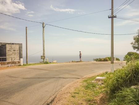 highs: Lonely man watching the nice view from the highs of San Antonio hill in the city of Piriapolis, one of the famous watering places in Uruguay South America.