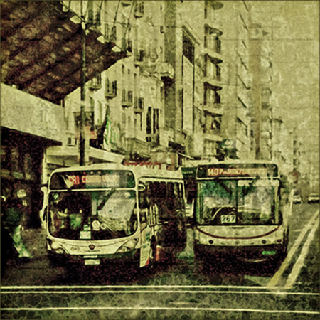 julio: Montevideo, Uruguay, August - 2009 - Square format digital photo manipulated grunge vintage stlye urban scene wth two buses on the main avenue of Montevideo, the capital of Uruguay. Editorial