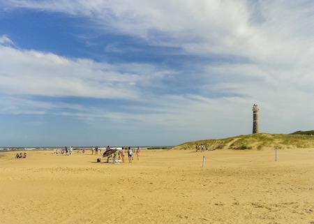 ignacio: Beautiful day at the beach in Jose Ignacio in Uruguay with the famous lighthouse landmark at background.