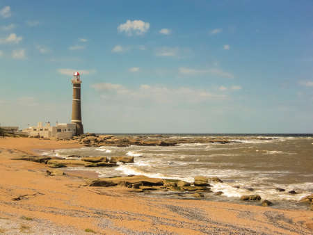 ignacio: Beautiful summer day at the beach with the lighthouse as the main subject in Jose Ignacio, an exclusive watering place in Uruguay