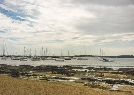 wheater: Group of many yachts and boats in a cloudy and tranquil day at the port in Punta del Este, the most famous seaside resort of Uruguay Stock Photo