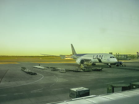 provision: Perspective view of plane parked at airport receiving provision in Carrasco airport in Uruguay.