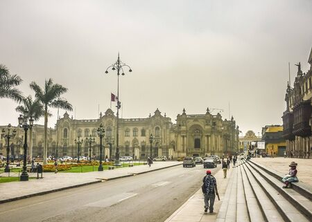 municipal editorial: Lima, Peru, April 2014 - Beautiful neoclassical style building in Plaza Mayor in the historic center of Lima city in Peru, South America Editorial