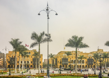 municipal editorial: LIMA, PERU, APRIL 2014 - Plaza Mayor with  beautiful colonial style yellow buildings as the main subject in the historic center of Lima city in Peru, South America Editorial