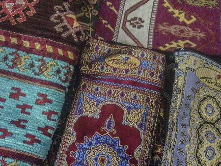 Beautiful turkish fashion accessories close up view with complex ornament decorations in colorful mixed colors. photo