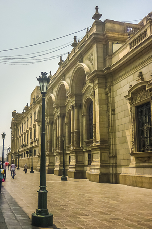 Low angle view of beautiful neoclassical style building in Plaza Mayor in the historic center of Lima city in Peru, South America