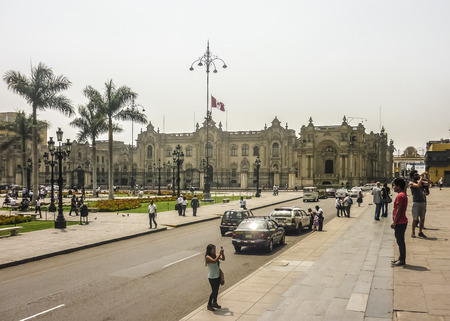 municipal editorial: Lima, Peru, April 2014 - Lots of tourist in the historic center in Plaza Mayor of Lima city in Peru, South America