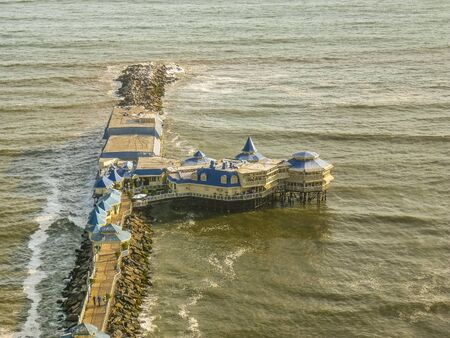 highs: Aerial view of famous restaurant in the middle of the pacific ocean at the coast in the city of Lima in Peru