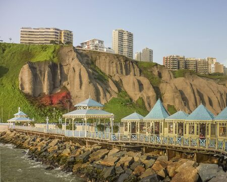 ravine: Nice sidewalk with commercial stores in the breakwater at the middle of the pacific ocean at the coast in the city of Lima in Peru Stock Photo