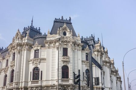 architrave: Low angle view french style neoclassical ornate building in white and blue colors in the city of Lima in Peru.