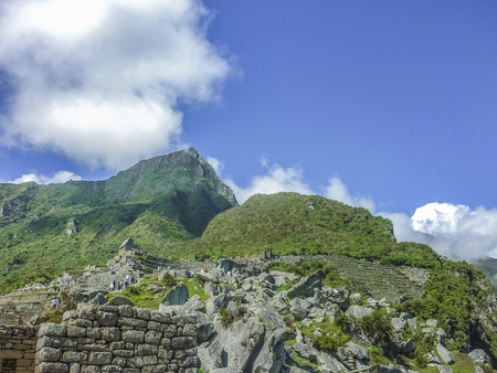 inca architecture: low angle view of architecture and nature surrounded in the most famous landmark of Cuzco in Peru, the ancient inca city of Machu Picchu. Stock Photo