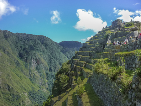 Aerial view of terraces and architecture in the highs of the most famous landmark of Cuzco in Peru, the ancient inca city of Machu Picchu.