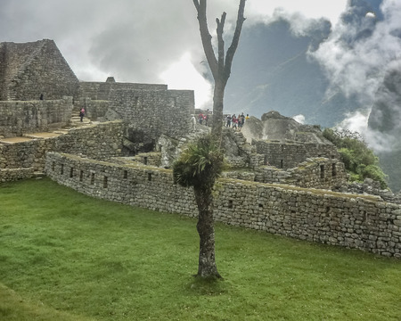 highs: Aerial view of architecture and nature surrounded from the highs of the most famous landmark of Cuzco in Peru, the ancient inca city of Machu Picchu.