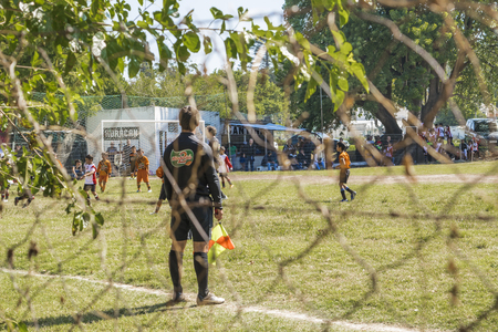 spectator: MONTEVIDEO, URUGUAY, MARCH - Spectator view photo of soccer match between two children teams in a sunny day in Montevideo, the capital of Uruguay in South America. Editorial