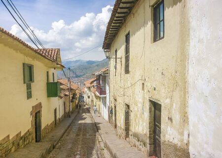 spanish houses: Perspective view of traditional spanish colonial style street and houses in the city of Cusco in Peru, South America.