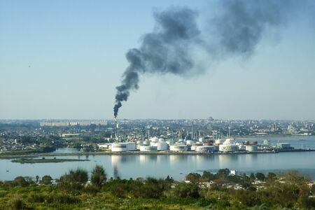 artigas: Aerial view of west coast of Montevideo with a big cloud of smoke from the oil refinery as the main subject. Stock Photo