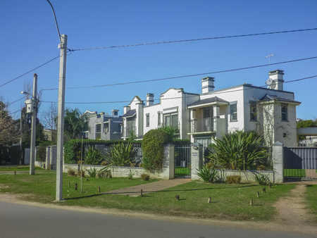 outsides: Perspective view of a tranquil and nice street of Parque Miramar neighbourhood in the outsides of Montevideo in Uruguay Editorial