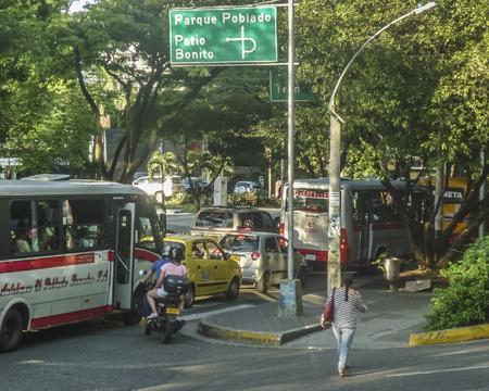 medellin: MEDELLIN, COLOMBIA, DECEMBER - 2014 - Traditional street of El Poblado neighbourhood, one of the most exclusive places in Medellin, Colombia. Editorial