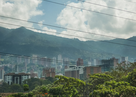 neighbourhood: Beautiful urban view of city and mountains from subway station in El Poblado neighbourhood, one of the most exclusive places in Medellin, Colombia.