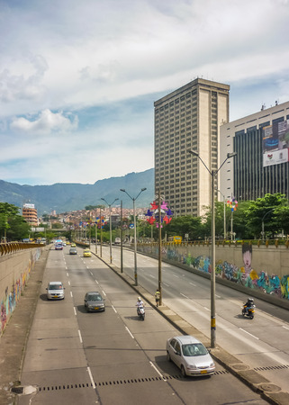 antioquia: MEDELLIN, COLOMBIA, DECEMBER - 2014 - Aerial view of modern business buildings and highway with andes range mountains at background in Medellin, one of the most important cities of Colombia.