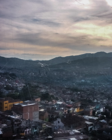antioquia: Aerial view of poor town and big mountains in the city of Medellin, one of the most important cities of Colombia.