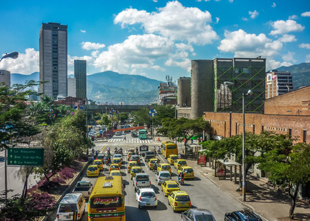 MEDELLIN, COLOMBIA, DECEMBER - 2014 - Aerial view of modern business buildings and highway with andes range mountains at background in Medellin, one of the most important cities of Colombia.