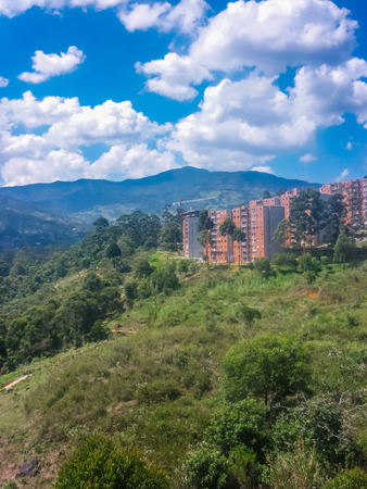 highs: Aerial distant view from cableway of housing complex and mountains at highs in the city of Medellin,one of the most important cities of Colombia.