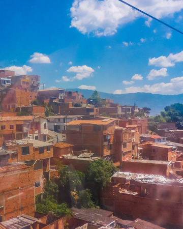 medellin: Aerial view from cableway of houses and mountains in a poor zone in the city of Medellin,one of the most important cities of Colombia.