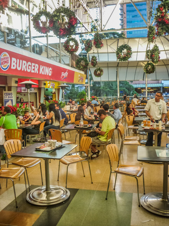 holiday lights display: MEDELLIN, COLOMBIA, DECEMBER - 2014 - People at food court at interior of shooping mall in the city of Medellin in Colombia, South America.