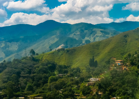 antioquia: Beautiful aerial view of mountains from and cloudy sky at sunny day in the highs of Medellin, one of the most important cities of Colombia, in South America Stock Photo