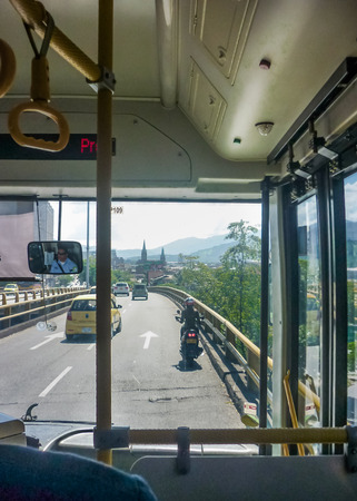 go inside: MEDELLIN, COLOMBIA, DECEMBER - 2014 - Inside bus view of avenue street in Medellin, one of the most important cities of Colombia.