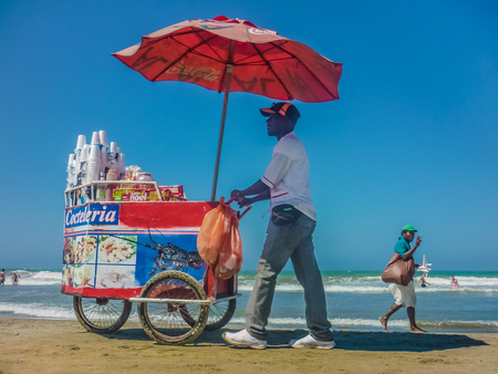 CARTAGENA, COLOMBIA, DECEMBER - 2014 - Traditional colombian vendors on the beach in Cartagena, the most famous seaside resort of Colombia, South America.